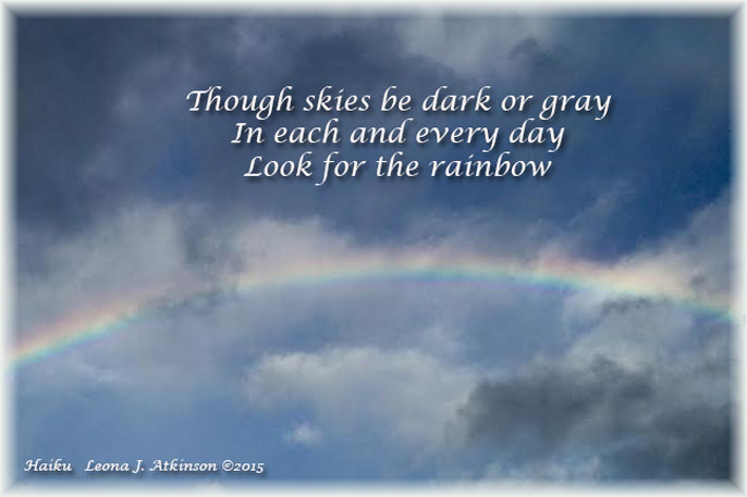 Haiku--Rainbow in the clouds photo