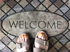 feet on welcome mat