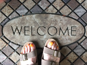 feet on welcome mat