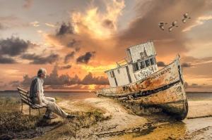 Old man, old ship, sunset