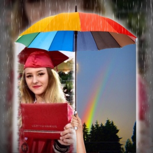 My Granddaughter with diploma, rain,and rainbow