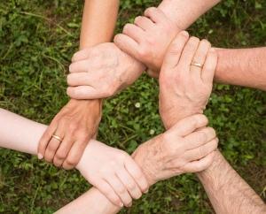 Hands linked together, helping hands