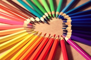 Colored pencils forming a heart shape