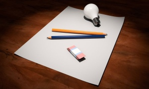 Blank paper, pencils, eraser, light bulb