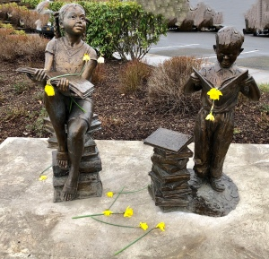 Statues at Library decorated with daffodils