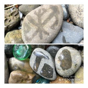 Rocks with hieroglyphic type wet imprints on them