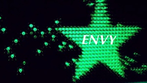 Green star in night sky symbolizes Envy