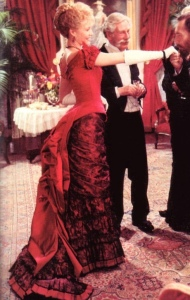 "Image of Ellen in her red evening gown from the movie ""The Age of Innocence"", http://www.frockflicks.com/age-of-innocence-bustles/"