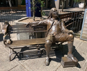 Statue of Benjamin Franklin on bench in McMinnville,OR