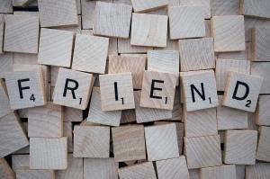 Scrabble letters spell Friend