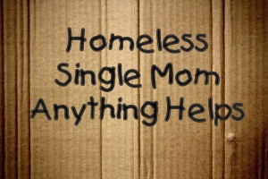"Cardboard sign saying ""Homeless—Single Mom"""