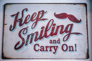 "Sign ""Keep Smiling and Carry On"""