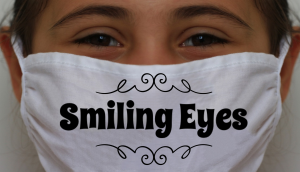 Girl with smiling eyes wearing a face mask