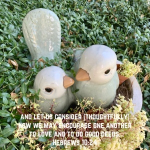 Two birds in a nest lawn ornament